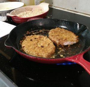 pork chops in fry pan